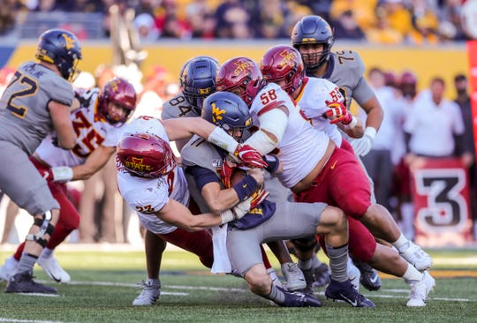 Oct 12, 2019; Morgantown, WV, USA; Iowa State Cyclones linebacker Mike Rose (23) and Iowa State Cyclones defensive lineman Ray Lima (58) sack West Virginia Mountaineers quarterback Jack Allison (11) during the second quarter at Mountaineer Field at Milan Puskar Stadium.
