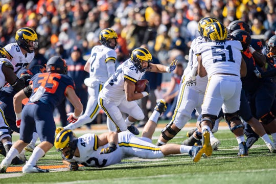 Oct 12, 2019; Champaign, IL, USA; Michigan Wolverines running back Zach Charbonnet (24) runs the ball during the first half against the Illinois Fighting Illini at Memorial Stadium.