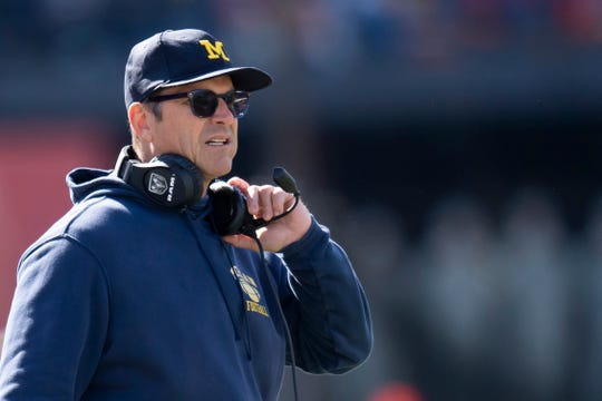 Oct 12, 2019; Champaign, IL, USA; Michigan Wolverines head coach Jim Harbaugh looks on during the first half against the Illinois Fighting Illini at Memorial Stadium.