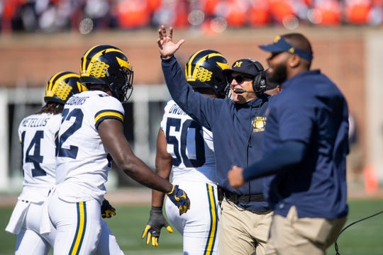 Oct 12, 2019; Champaign, IL, USA; Michigan Wolverines head coach Jim Harbaugh celebrates a touchdown during the first half against the Illinois Fighting Illini at Memorial Stadium.