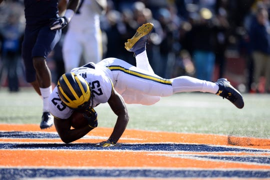 Oct 12, 2019; Champaign, IL, USA; Michigan Wolverines running back Hassan Haskins (25) rolls into the end zone during the game against the Illinois Fighting Illini at Memorial Stadium.