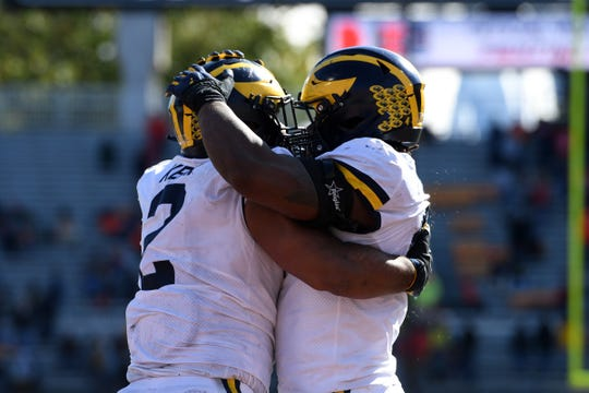 Carlo Kemp (2) and Michael Danna (4) celebrate a defensive stop during the second half against Illinois.