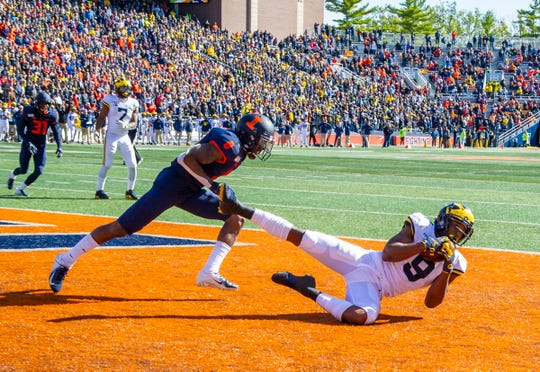 Oct 12, 2019; Champaign, IL, USA; Michigan receiver Donovan Peoples-Jones catches a touchdown against Illinois defensive back Nate Hobbs during the second half at Memorial Stadium.