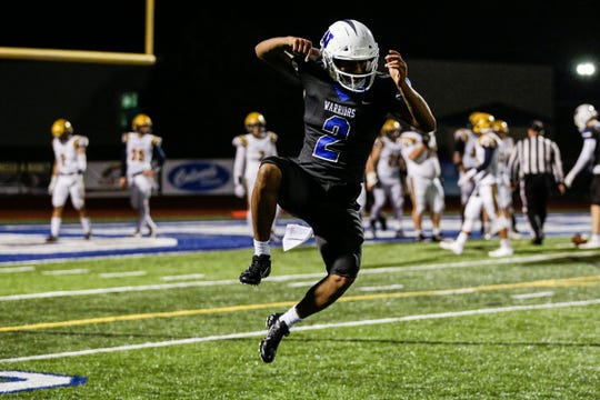 Walled Lake Western quarterback Abdur-Rahmaan Yaseen (2) celebrates a touchdown pass he made against South Lyon during the second half at Walled Lake Western High School in Walled Lake, Friday, Oct. 11, 2019.