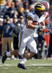 Zach Charbonnet of Michigan runs the ball during the first half against Illinois on Oct. 12.