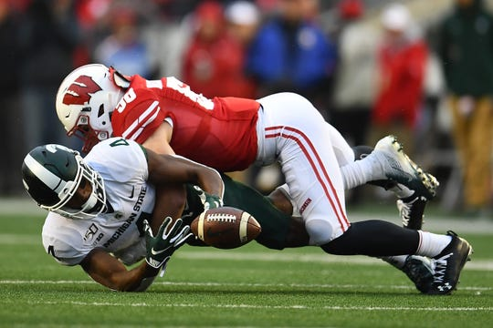 Wisconsin's Mike Maskalunas defends a pass intended for Michigan State's C.J. Hayes during the second half of a game at Camp Randall Stadium on Oct. 12, 2019 in Madison, Wis..