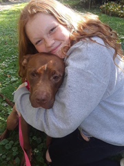 Lily Depaulis, 14, hugs her new fur baby, Ellie. Lily and her mom attended the DACC Empty the Shelters event on Satuday.