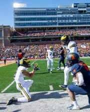 Oct 12, 2019; Champaign, IL, USA; Michigan Wolverines wide receiver Ronnie Bell (left) and tight end Nick Eubanks (82) celebrate during the first half against the Illinois Fighting Illini at Memorial Stadium.