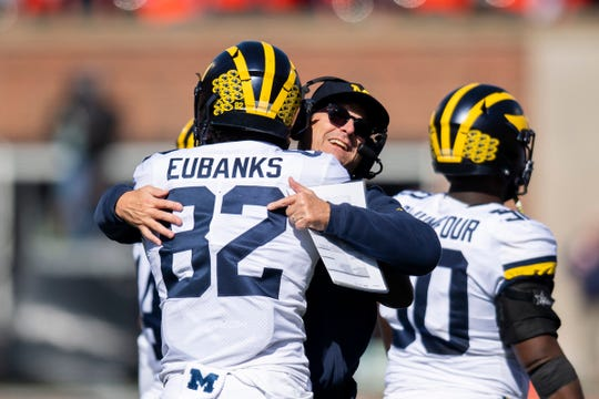 Oct 12, 2019; Champaign, IL, USA; Michigan Wolverines head coach Jim Harbaugh celebrates a touchdown with tight end Nick Eubanks (82) during the first half against the Illinois Fighting Illini at Memorial Stadium.