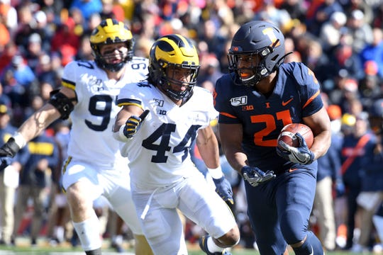 Oct 12, 2019; Champaign, IL, USA; Illinois Fighting Illini running back Ra'Von Bonner (21) is chased by Michigan Wolverines linebacker Cameron McGrone (44) and linebacker Khaleke Hudson (7) during the first half of the game at Memorial Stadium.