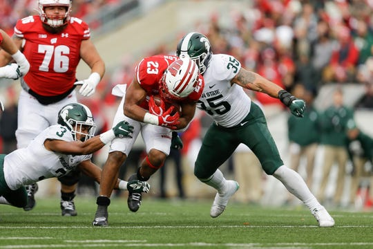 Wisconsin's Jonathan Taylor runs against Michigan State on Saturday.