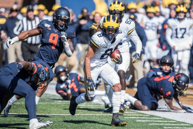 Michigan's Ronnie Bell (8) run after a pass reception in the first half of an NCAA college football game against Illinois, Saturday, Oct. 12, 2019, in Champaign, Ill. (AP Photo/Holly Hart)