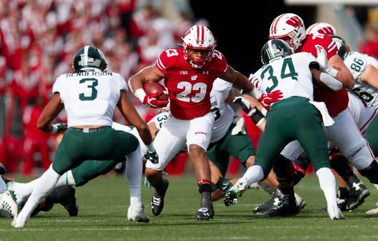 Oct 12, 2019; Madison, WI, USA; Wisconsin Badgers running back Jonathan Taylor (23) rushes with the football during the first quarter against the Michigan State Spartans at Camp Randall Stadium.