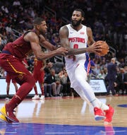Andre Drummond drives against Tristan Thompson during the third quarter Friday at Little Caesars Arena.