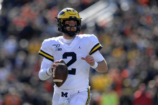 Michigan quarterback Shea Patterson looks to pass the ball during the second half against Illinois at Memorial Stadium, Oct. 12, 2019.