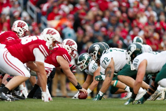 The Wisconsin Badgers line up for a play during the third quarter against the Michigan State Spartans at Camp Randall Stadium. Mandatory Credit: Jeff Hanisch-USA TODAY Sports