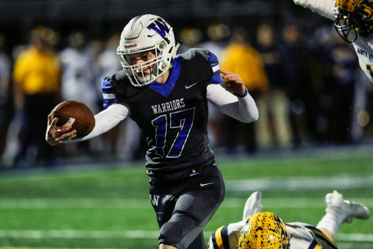 Walled Lake Western quarterback Jonathan Abele scores a touchdown against South Lyon during the first half in Walled Lake, Friday, Oct. 11, 2019.