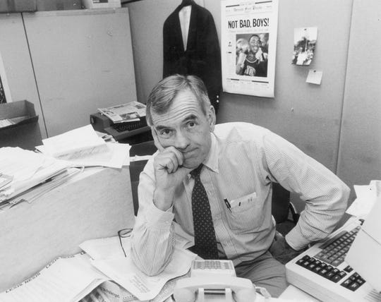 Hugh McDiarmid sits at his desk, June 13, 1990.