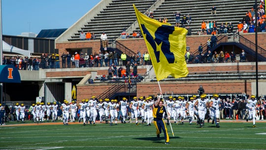 Oct 12, 2019; Champaign, IL, USA; The Michigan Wolverines enter the field prior to the first half against the Illinois Fighting Illini at Memorial Stadium.