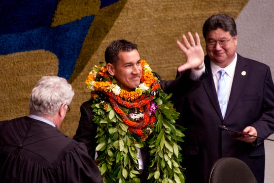 State Sen. Kai Kahele, center, waving at the Hawaii State Capitol in Honolulu in 2016.