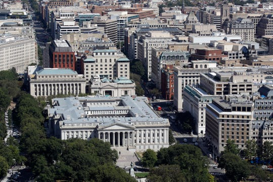 The U.S. Treasury Department building, bottom left, and downtown Washington viewed from the Washington Monument, Wednesday, Sept. 18, 2019, in Washington.