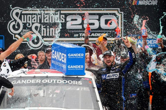 Camping World Truck Series driver Spencer Boyd (20) celebrates in Victory Lane after being declared the winner as driver Johnny Sauter (13) was disqualified in the Sugarlands Shine 250 at Talladega Superspeedway on Saturday.