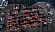 Cargo containers are staged near cranes at the Port of Tacoma, in Tacoma, Wash.