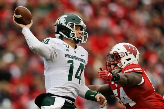 Michigan State quarterback Brian Lewerke was 7-of-16 for 53 yards before being replaced by Rocky Lombardi in Saturday's 38-0 loss to Wisconsin.