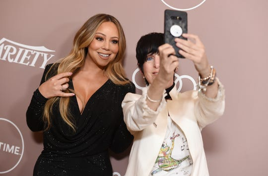 Mariah Carey, left, and Diane Warren take a selfie at Variety's Power of Women on Friday, Oct. 11, 2019, at the Beverly Wilshire hotel in Beverly Hills, Calif.