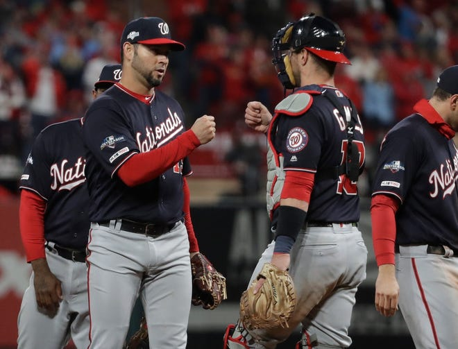 Washington Nationals starting pitcher Anibal Sanchez is congratulated by catcher Yan Gomes after being taken out of the game during the eighth inning on Friday.