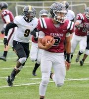 Ethan Simpson of Elmira runs for a touchdown in a 55-21 win over Henninger on Oct. 12, 2019 at Ernie Davis Academy.