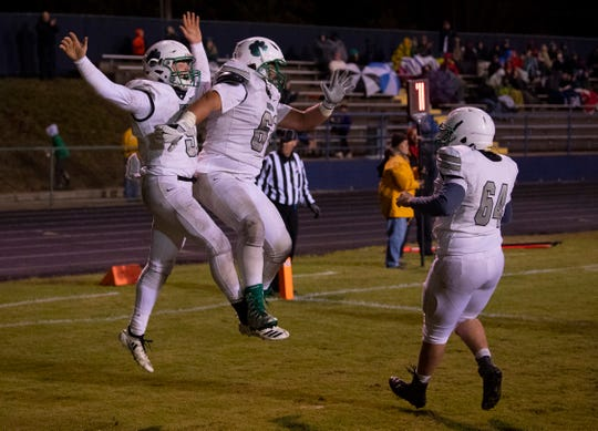 North's Ethan Brawdy (5) celebrates with is offensive line after scoring a touchdown against Castle at John Lidy Field Friday night.