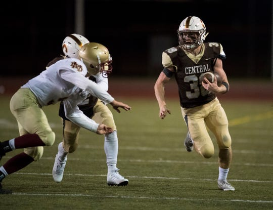 Central's Brennan Schutte (38) carries the ball during the Mater Dei Wildcats  vs Central Bears  game at Central Stadium Friday evening, Oct. 11, 2019.