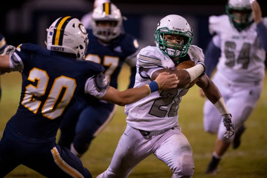 North's Capoleton Presswood (28) rushes against the Castle defense at John Lidy Field Friday night.
