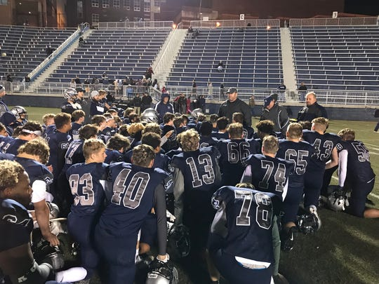 Reitz head coach Andy Hape talks with his team after Friday's 19-14 win over Bosse.