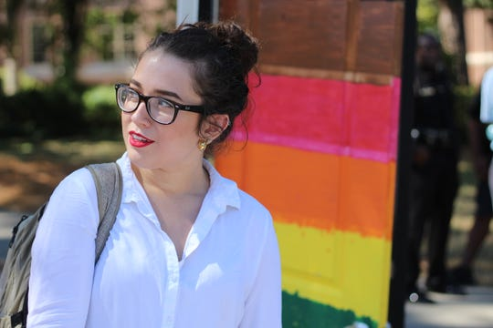 Students gathered at Landis Green to march for LGBTQ+ visibility on National Coming Out Day.
