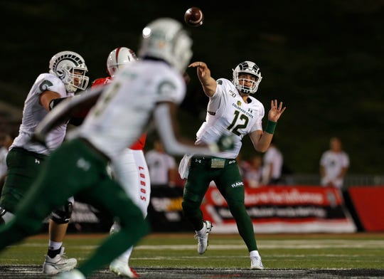 Colorado State quarterback Patrick O'Brien (12) throws a pass intended for wide receiver Warren Jackson (9) during the first half of an NCAA college football game against New Mexico on Friday, Oct. 11, 2019 in Albuquerque, N.M.