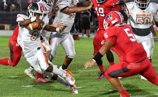 Dunbar High School Roger Mottley III (8) runs the ball during their Friday night matchup with North Fort Myers High School on Friday, Oct. 11, 2019.