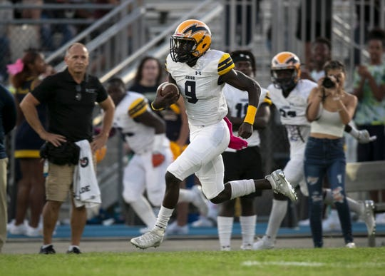 Richard Young of Lehigh runs in a touchdown in the first quarter of the Battle for the Bell game on Friday, October 11, 2019, at Riverdale High School.