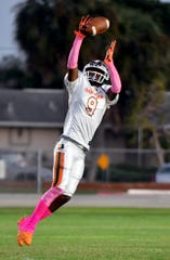 Dunbar High School Shawn Russ Jr. (9) jumps for the ball during their Friday night matchup with North Fort Myers High School on Friday, Oct. 11, 2019.