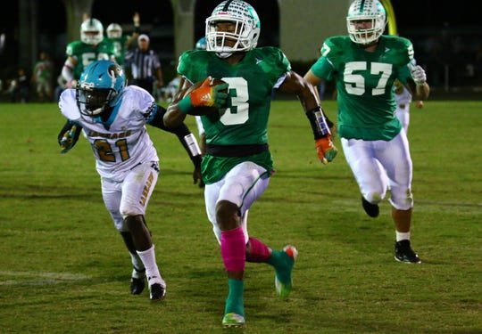 John Coleus of Fort Myers runs the ball against East Lee during their homecoming game on Friday, Oct. 11, 2019, at Fort Myers High School.