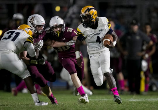 Percy Milledge runs the ball for Lehigh during the Battle for the Bell game on Friday, October 11, 2019, at Riverdale High School.