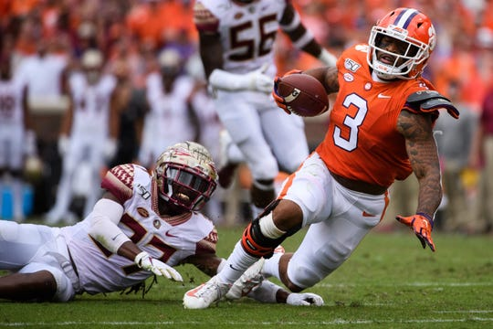 Clemson wide receiver Amari Rodgers (3) is taken down by Florida State defensive back Akeem Dent (27) during their game at Memorial Stadium Saturday, October 12, 2019.