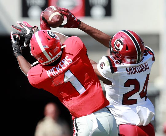 South Carolina defensive back Israel Mukuamu intercepts a pass intended for Georgia wide receiver George Pickens during the second quarter of an NCAA college football game, Saturday, Oct., 12, 2019, in Athens, Ga. Mukuamu returned the ball for a touchdown.
