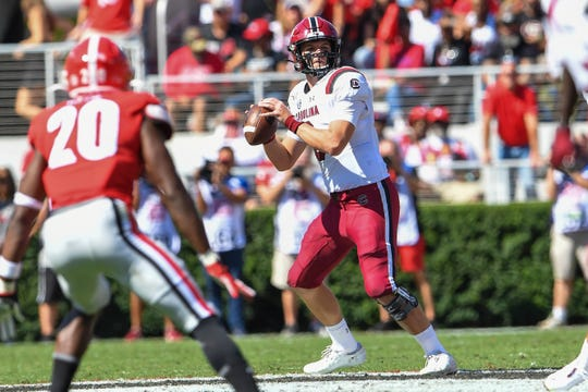 South Carolina Gamecocks quarterback Ryan Hilinski (3) looks for a receiver prior to throwing for a touchdown pass against the Georgia Bulldogs during the first quarter at Sanford Stadium.