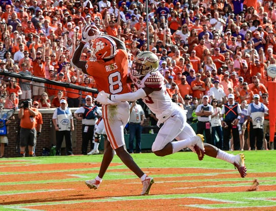 Clemson wide receiver Justyn Ross (8) catches a pass for a touchdown against Florida State during the second quarter at Memorial Stadium before the game with Florida State in Clemson, South Carolina Saturday, October 12, 2019.