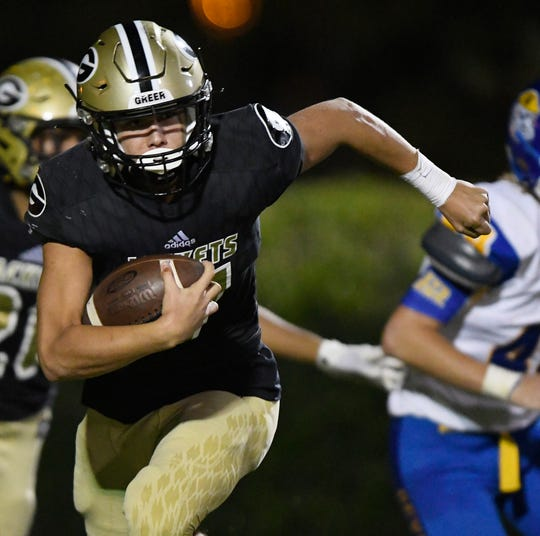 Greer quarterback Hollis Crosby (17) rushes against Travelers Rest Friday, October 11, 2019, at Dooley Field.