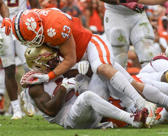 Clemson linebacker Chad Smith (43) tackles Florida State running back Cam Akers(3) during the second quarter at Memorial Stadium before the game with Florida State in Clemson, South Carolina Saturday, October 12, 2019.