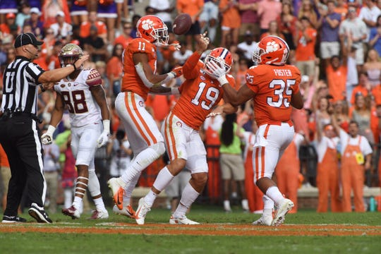 Clemson safety Tanner Muse (19) celebrates after intercepting Florida State in the first half on Saturday, Oct. 12, 2019.