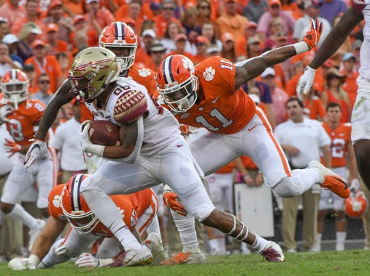 Clemson safety Isaiah Simmons (11) tackles Florida State wide receiver Tre'Shaun Harrison(88) during the second quarter at Memorial Stadium before the game with Florida State in Clemson, South Carolina Saturday, October 12, 2019.